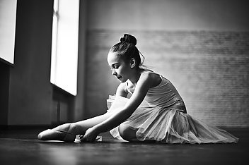 young girl stretching in her Ballet outfit funded by HAVlife